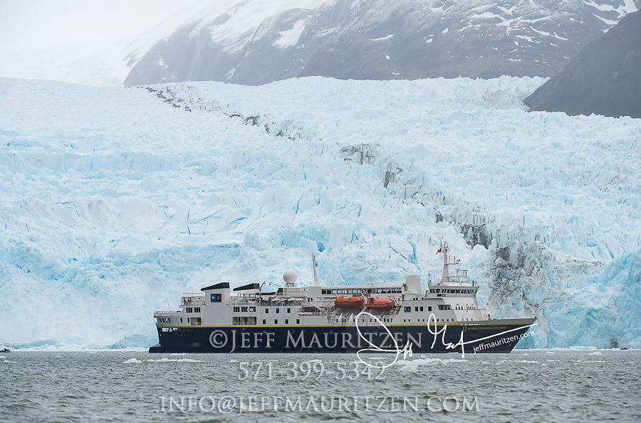 The National Geographic Explorer expedition ship in front of Garibaldi Glacier in Parque Nacional Alberto de Agostini, Chile.
