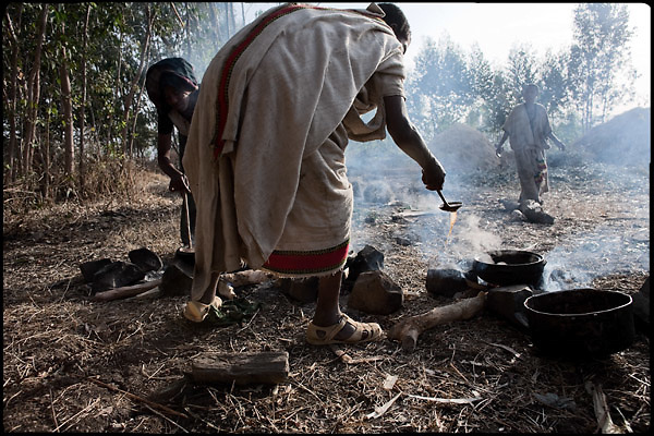 "Women prepare food for a marriage's celebration, in which two child brides have just married with boys of 10 years largest. The legal age to get married in Ethiopia is 18, the law is quite often ignored. Education is the most important key to helping end the practice of forced child marriages. Many believe that education may prove to be more successful in preventing child marriages than banning child marriages..North West of Ethiopia, on saturday, Febrary 14 2009.....In a tangled mingling of tradition and culture, in the normal place of living, in a laid-back attitude. The background of Ethiopia's ""child brides"", a country which has the distinction of having highest percentage in the practice of early marriages despite having a law that establishes 18 years as minimum age to get married. Celebrations that last days, their minds clouded by girls cups of tella and the unknown for the future. White bridal veil frame their faces expressive of small defenseless creatures, who at the age ranging from three to twelve years shall be given to young brides men adults already...To protect the identities of the recorded subjects names and specific places are fictional."