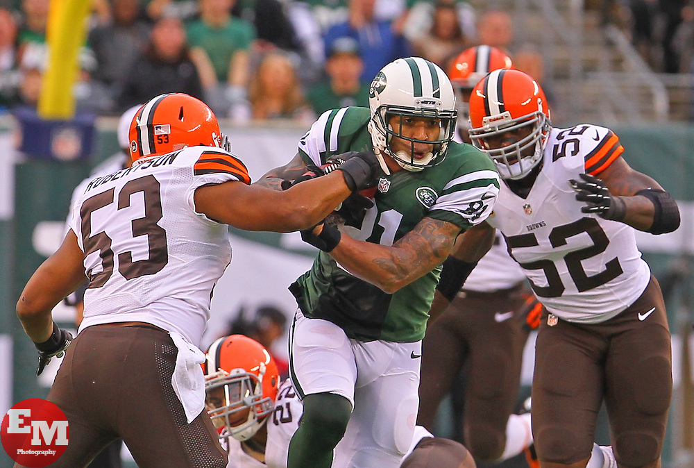 Dec 22, 2013; East Rutherford, NJ, USA; New York Jets tight end Kellen Winslow (81) runs with the ball past Cleveland Browns inside linebacker Craig Robertson (53) and Cleveland Browns inside linebacker D'Qwell Jackson (52) during the first half at MetLife Stadium.