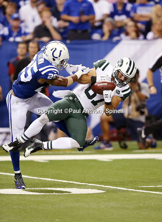 New York Jets wide receiver Eric Decker (87) gets tackled by Indianapolis Colts defensive back Jalil Brown (25) as he dives while trying to catch an incomplete fourth quarter pass during the 2015 NFL week 2 regular season football game against the Indianapolis Colts on Monday, Sept. 21, 2015 in Indianapolis. The Jets won the game 20-7. (©Paul Anthony Spinelli)