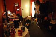 The Red Hot Chili Peppers are seen in the dressing room before they perform on Fuse in Manhattan, NY. Anthony Kiedis does push-ups. They have released a new album. 5/9/2006 Photo by Jennifer S. Altman