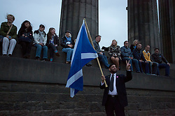 © Licensed to London News Pictures. 14/09/2014. Edinburgh, UK. A group from the Yes campaign pose for a photo with a Saltire from the top of the Scottish National Monument in Calton Hill, Edinburgh. Photo credit: Isabel Infantes / LNP