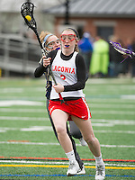 Becca Howe of Laconia takes the ball down field during the girls lacrosse scrimmage with Windham held on Saturday afternoon.  (Karen Bobotas/for the Laconia Daily Sun)