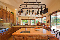 Kitchen counter with utensils hanging in luxury villa