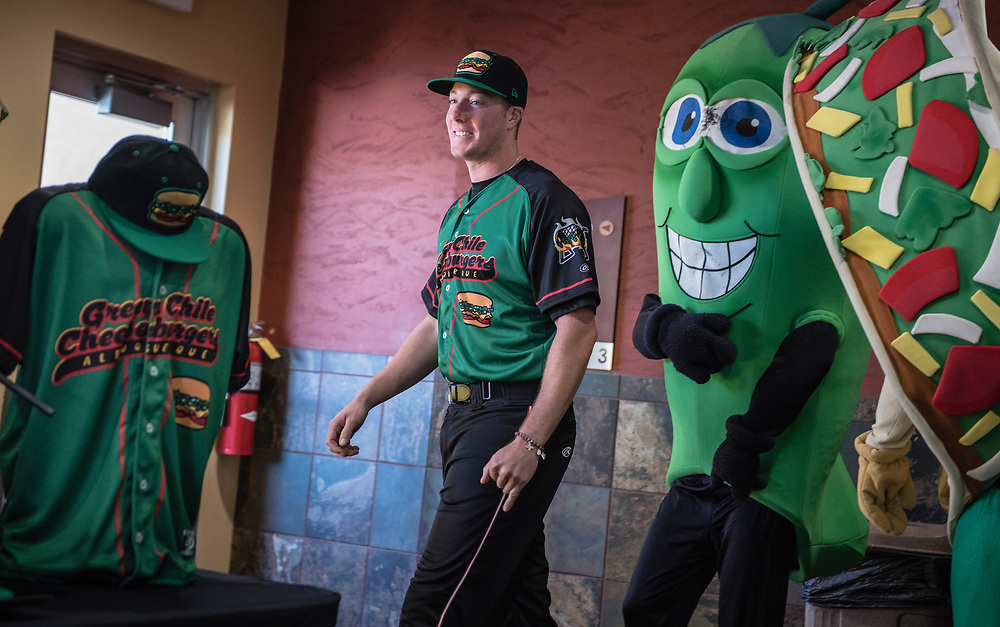 rer042017b/sports/04.20.2017/Roberto E. Rosales <br /> On June 16, 2017, for one night only, the Albuquerque Isotopes will become the Albuquerque Green Chile Cheeseburgers as a promotional move.  Pictured is Albuquerque native pitcher Austin House(Cq) wearing the uniform the team will wear on that day.<br /> Albuquerque, New Mexico(Roberto E. Rosales/Albuquerque Journal)