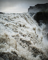 Close-up shot of water rushing down Dettifoss waterfall in North Iceland.