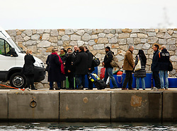 Relatives of missing persons from the Costa Concordia cruise ship which ran aground off the west coast of Italy arrive on Giglio island January 27, 2012. Costa Cruises has offered to pay 11,000 euros ($14,500) in compensation to each of the more than 3,000 passengers aboard the ship that capsized near the island of Giglio two weeks ago, Italian consumer groups said on Friday.<br /> REUTERS/Darrin Zammit Lupi (ITALY)