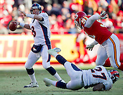 KANSAS CITY, MO - DECEMBER 5:   Kyle Orton #8 of the Denver Broncos throws a pass against the Kansas City Chiefs on December 5, 2010 at Arrowhead Stadium in Kansas City, Missouri.  The Chiefs defeated the Broncos 10-6.  (Photo by Wesley Hitt/Getty Images) *** Local Caption *** Kyle Orton