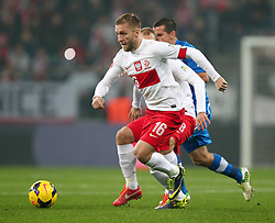 15.11.2013, National Stadium, Warschau, POL, Fussball Testspiel, Polen vs Slovakei, im Bild JAKUB KUBA BLASZCZYKOWSKI POLSKA // JAKUB KUBA BLASZCZYKOWSKI POLSKA during the international friendly match between Poland and Slovakia at the National Stadium in Warschau, Poland on 2013/11/15. EXPA Pictures © 2013, PhotoCredit: EXPA/ Newspix/ Michal Nowak<br /> <br /> *****ATTENTION - for AUT, SLO, CRO, SRB, BIH, MAZ, TUR, SUI, SWE only*****