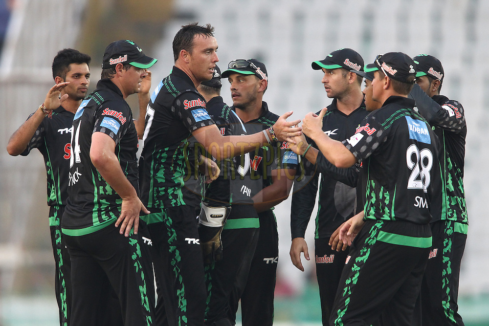 Kyle Abbott of the Dolphins is congratulated for getting Perth Scorchers captain Adam Voges wicket during match 4 of the Oppo Champions League Twenty20 between the Dolphins and the Perth Scorchers held at the Punjab Cricket Association Stadium, Mohali, India on the 20th September 2014<br /> <br /> Photo by:  Shaun Roy / Sportzpics/ CLT20<br /> <br /> <br /> Image use is subject to the terms and conditions as laid out by the BCCI/ CLT20.  The terms and conditions can be downloaded here:<br /> <br /> http://sportzpics.photoshelter.com/gallery/CLT20-Image-Terms-and-Conditions-2014/G0000IfNJn535VPU/C0000QhhKadWcjYs