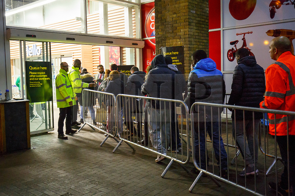 © Licensed to London News Pictures. 26/11/2015. London, UK. Black Friday shoppers queueing to buy reduced products outside a Tesco Extra store in Edmonton, north London on Friday, 27 November 2015. Photo credit: Tolga Akmen/LNP