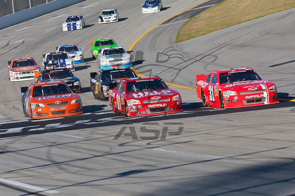 SPARTA, KY - SEP 22, 2012:  Justin Allgaier (31), Mike Wallace (01), and Eric McClure (14) race during the Kentucky 300 at the Kentucky Speedway in Sparta, KY.