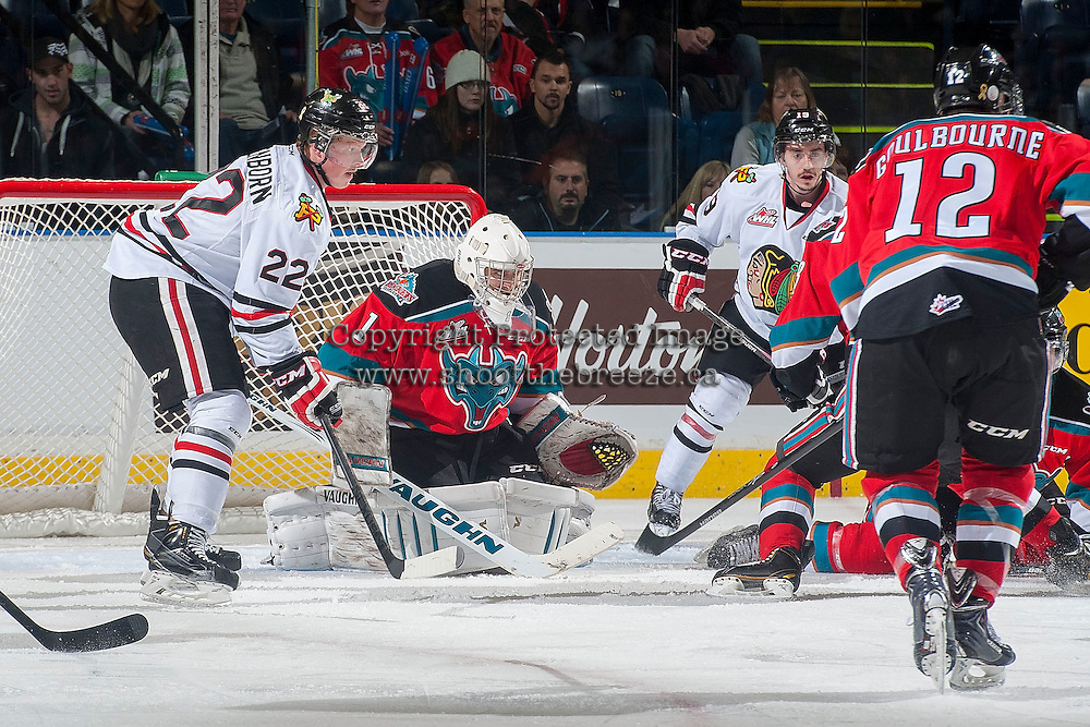 KELOWNA, CANADA - NOVEMBER 21: Alex Schoenborn #22 of Portland Winterhawks looks for the pass as Jackson Whistle #1 of Kelowna Rockets defends the net on November 21, 2014 at Prospera Place in Kelowna, British Columbia, Canada.  (Photo by Marissa Baecker/Shoot the Breeze)  *** Local Caption *** Alex Schoenborn; Jackson Whistle;