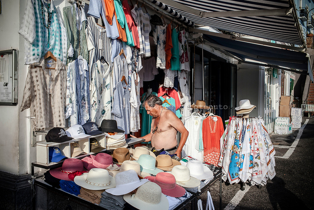 04 August 2017, Capri Italy - Merchant prepare his shop in Marina Grande before the arrival of the tourists on the Capri Island.