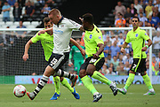 Jamie O'Hara holding off a gaggle of brighton players during the Sky Bet Championship match between Fulham and Brighton and Hove Albion at Craven Cottage, London, England on 15 August 2015. Photo by Matthew Redman.