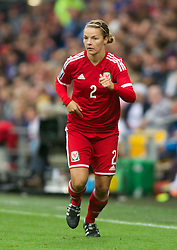 CARDIFF, WALES - Tuesday, August 21, 2014: Wales' Loren Dykes in action against England during the FIFA Women's World Cup Canada 2015 Qualifying Group 6 match at the Cardiff City Stadium. (Pic by Ian Cook/Propaganda)
