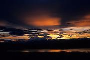 The sun sets over the Alaska Range near the village of Denali, Alaska.