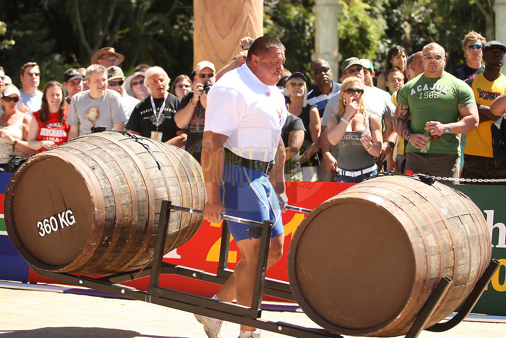 Mikhail Koklyaev (Russia) on the return leg of the whiskey-barrel walk during the final rounds of the World's Strongest Man competition held in Sun City, South Africa.