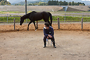 Saito Takahashi training horses in rural Fukushima inside the 30 kilometre exclusion zone created to limit exposure to radiation from the Fukushima Daichi nuclear power plant that was damaged in the March 11th earthquake and tsunami. Fukushima, Wednesday May 4th 2011