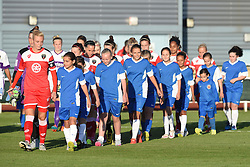 Mascots escort the Bristol Academy Women players on to the pitch at Stoke Gifford Stadium - Mandatory by-line: Paul Knight/JMP - Mobile: 07966 386802 - 27/08/2015 -  FOOTBALL - Stoke Gifford Stadium - Bristol, England -  Bristol Academy Women v Oxford United Women - FA WSL Continental Tyres Cup
