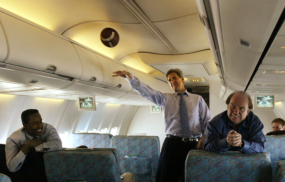 United States Senator and Democratic Presidential hopeful John Kerry tosses a football with staff members as staff members Setti Warren (L) and Bob Shrum watch aboard his campaign plane while en route to St. Louis for a campaign stop Bedford, Massachusetts. Wednesday 28 January 2004. Kerry won the New Hampshire Primary last night EPA PHOTO/ANDREW GOMBERT