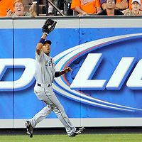 09 June 2009:  Seattle Mariners left fielder Endy Chavez (10) makes a running catch on a fly ball off the bat of Baltimore Orioles second baseman Brian Roberts in the 5th inning at Camden Yards in Baltimore, MD.  The Orioles defeated the Mariners 3-1.  ****For Editorial Use Only****