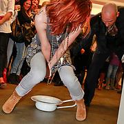 NLD/Amsterdam/20110324 - Opening Hers and His expositie van Eddy Zoey, opening expo waarbij partner Marieke in een po plast en Eddy dit opdrinkt