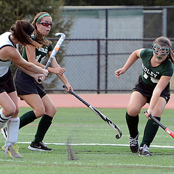 Radnor's Lexi Kenneally (6) fires a shot past Ridley's Kerrie Flynn (11) and Erin O'Kane (40) which eventually found its way into the goal late in the second half, giving Radnor the win during the Radnor at Ridley field hockey game, Thursday afternoon September 11, 2014. (Times staff / TOM KELLY IV)
