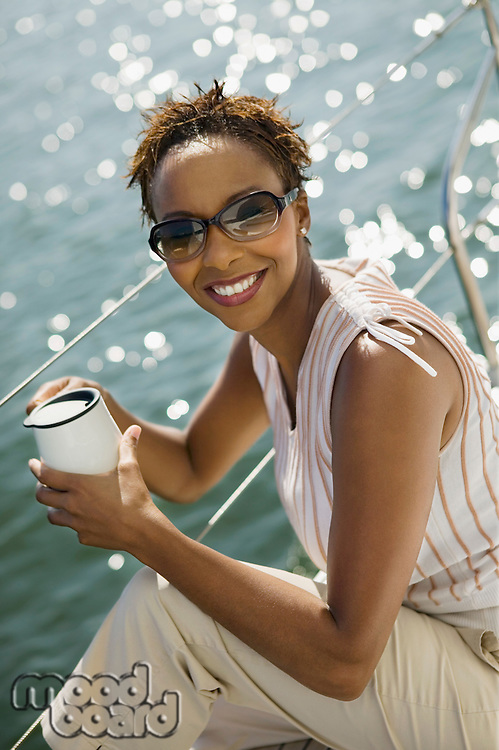Woman Drinking Coffee on Boat