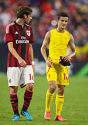 CHARLOTTE, USA - Saturday, August 2, 2014: Liverpool's Philippe Coutinho Correia and AC Milan's Andrea Poli during the International Champions Cup Group B match at the Bank of America Stadium on day thirteen of the club's USA Tour. (Pic by David Rawcliffe/Propaganda)