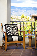 Stock Photo of Master Bedroom Balcony with Outdoor Furniture and View of Mountains