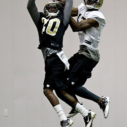 July 27, 2012; Metairie, LA, USA; New Orleans Saints wide receiver Joe Morgan (13) battles cornerback A.J. Davis (20) for a catch during training camp at the team's indoor practice facility. Mandatory Credit: Derick E. Hingle-US PRESSWIRE