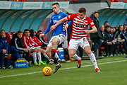 Rangers Ryan Kent and Hamilton Accies Aaron McGowan tangle on the touch line in front of the Hamilton Bench during the Ladbrokes Scottish Premiership match between Hamilton Academical FC and Rangers at The Hope CBD Stadium, Hamilton, Scotland on 24 February 2019.