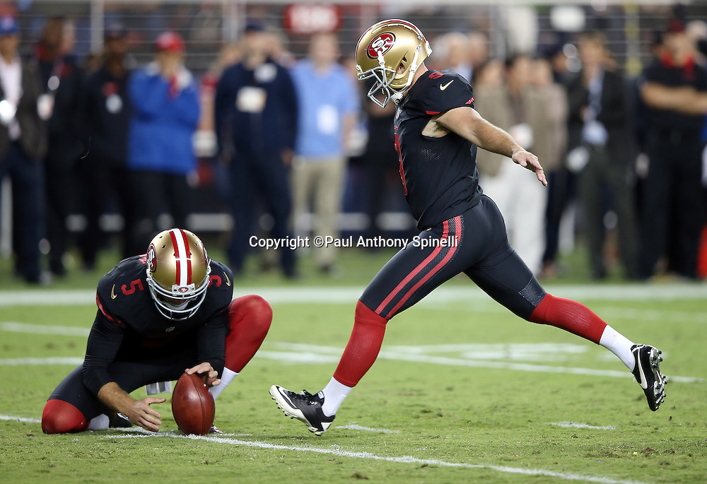 San Francisco 49ers rookie punter and holder Bradley Pinion (5) holds while San Francisco 49ers kicker Phil Dawson (9) kicks a fourth quarter field goal for a 20-3 lead during the 2015 NFL week 1 regular season football game against the Minnesota Vikings on Monday, Sept. 14, 2015 in Santa Clara, Calif. The 49ers won the game 20-3. (©Paul Anthony Spinelli)