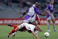 Fotball<br /> Frankrike 2004/05<br /> Toulouse v Ajaccio<br /> 11. september 2004<br /> Foto: Digitalsport<br /> NORWAY ONLY<br /> ACHILLE EMANA (TOU) / XAVIER COLLIN (AJA)