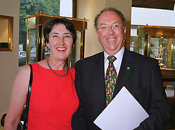 MR & MRS PETER JONES he is chairman of the Tote at a reception in London on 13th July 1999.MUE 6