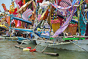 Decorated boats moored along the beach at the Maulid Nabi festival, Cikoang, Sulawesi, Indonesia.