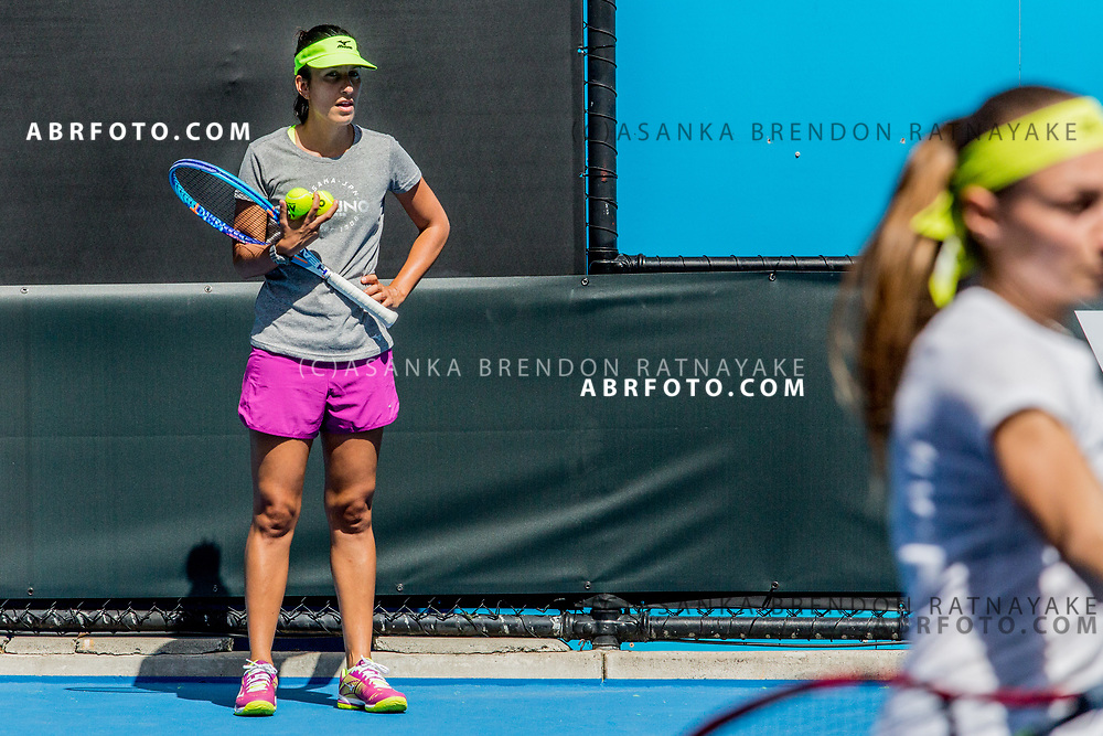 Coach, Elise Tamaëla looks on from the side as Aleksandra Krunić returns a forehand shot  during a training session at Melbourne Park in Melbourne, Australia on the 11th of January 2018. Asanka Brendon Ratnayake for The New York Times