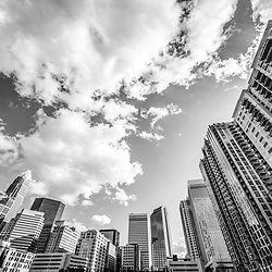 Charlotte skyline ultra wide angle black and white photo with a cloudy sky. Charlotte, North Carolina is a major city in the Eastern United States of America