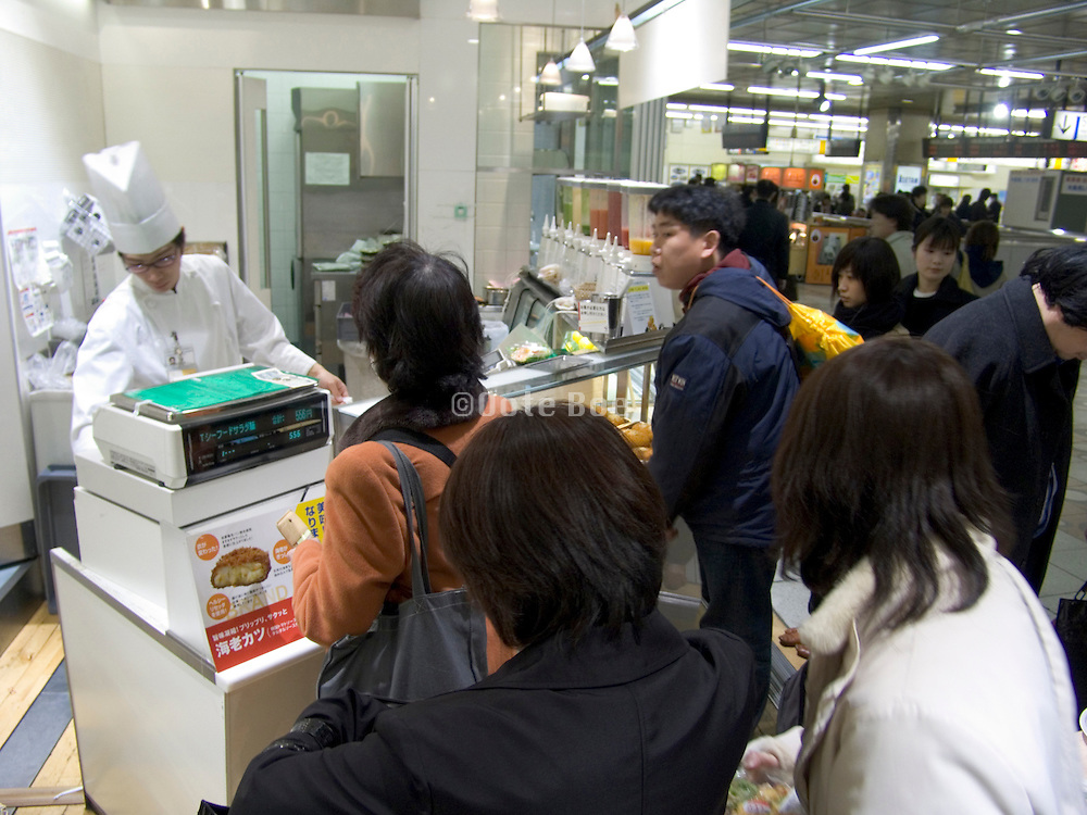 fast food store in a Tokyo train station