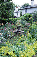urn with plants in centre of cottage garden