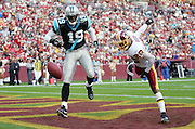 LANDOVER, MD - NOVEMBER 26:  Cornerback Carlos Rogers #22 of the Washington Redskins breaks up an end zone touchdown pass intended for wide receiver Keyshawn Johnson #19 of the Carolina Panthers at FedExField on November 26, 2006 in Landover, Maryland. The Redskins defeated the Panthers 17-13. ©Paul Anthony Spinelli *** Local Caption *** Carlos Rogers;Keyshawn Johnson