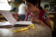 Yuliana Viloria de 11 años, hace su tarea escolar en casa de sus abuelos paternos. Gracias a FundaHigado, Yuliana recibió un trasplante de higado que le permite disfrutar de la vida. Punto Fijo, Venezuela 26 y 27 Oct. 2012. (Foto/ivan gonzalez)