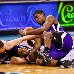 December 15, 2010; New Orleans Hornets guard Marcus Thornton (5) and Sacramento Kings point guard Beno Udrih (19) and center Jason Thompson (34) fight for possession of a loose ball during the second half at the New Orleans Arena. The Hornets defeated the Kings 94-91. Mandatory Credit: Derick E. Hingle