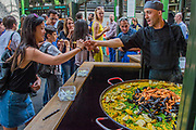 Visitors are happily tempted by tasters - The market reopening is signified by the ringing of the bell and is attended by Mayor Sadiq Khan. Tourists and locals soon flood back to bring the area back to life.