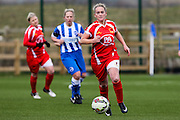 Cardiff's Kelly Isaac advances upfield during the FA Women's Premier League match between Brighton Ladies and Cardiff City Ladies at Brighton's Training Ground, Lancing, United Kingdom on 22 March 2015. Photo by Geoff Penn.