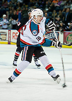 KELOWNA, CANADA - SEPTEMBER 5: Kole Lind #16 of Kelowna Rockets takes a shot on net and scores a first period goal against the Prince George Cougars on September 5, 2015 during the first pre-season game at Prospera Place in Kelowna, British Columbia, Canada.  (Photo by Marissa Baecker/Shoot the Breeze)  *** Local Caption *** Kole Lind;