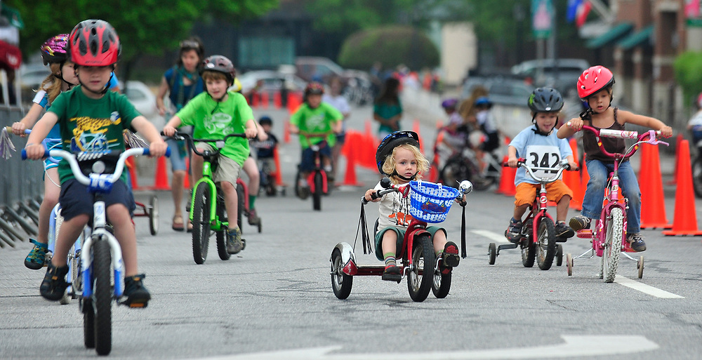 Boone Patterson, 3, pedals to keep up with the competition during the Twilight Kids Criterium in Downtown Athens, Ga, on Saturday, April 28, 2012.