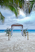 A beach wedding archway on a tropical resort.