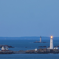 New England lighthouse photography of Boston Light and Graves Light at twilight. These two iconic Massachusetts lighthouses are located of the Hull, MA coast marking entry to the Boston Harbor.<br />